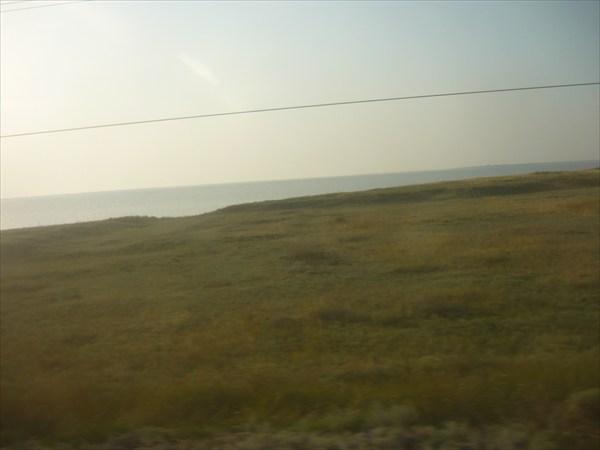 Со взгляда на пролив из окна поезда рано утром